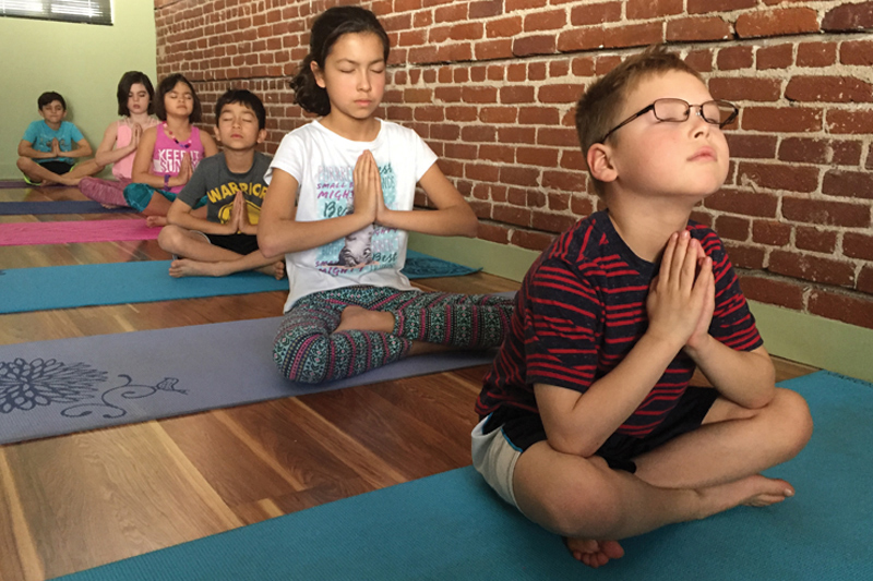 Kids' yoga is fast gaining favor with parents and teachers as a tool to build inner strength and peace.